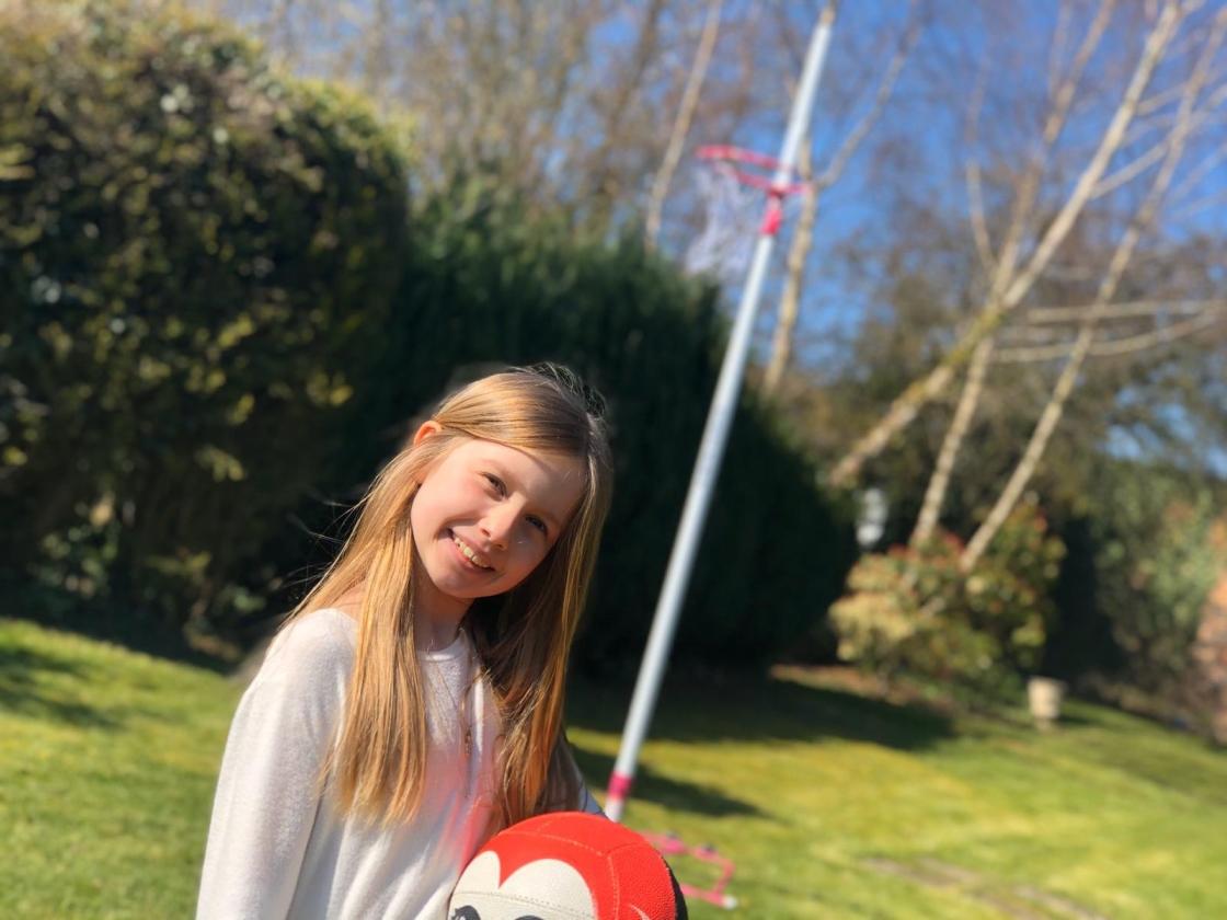 Isla and her netball post.