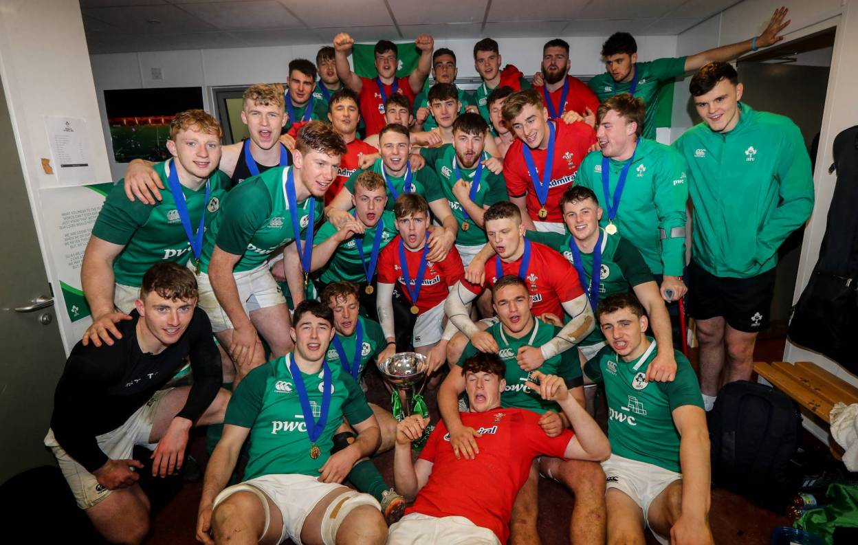 The Ireland Under-20s celebrate with the trophy in the dressing room after being crowned U-20 Six Nations Grand Slam champions in Colwyn Bay ©INPHO/Ryan Byrne