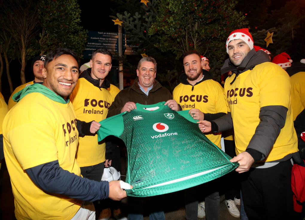 Irish Rugby players Bundee Aki, Johnny Sexton, Conor Murray and Rob Herring presented Focus Ireland Chief Executive Pat Dennigan with a signed Ireland Jersey as 45 players joined Focus Ireland's Christmas Choirs Campaign in Dublin City Centre Mandatory Credit ©INPHO/Dan Sheridan
