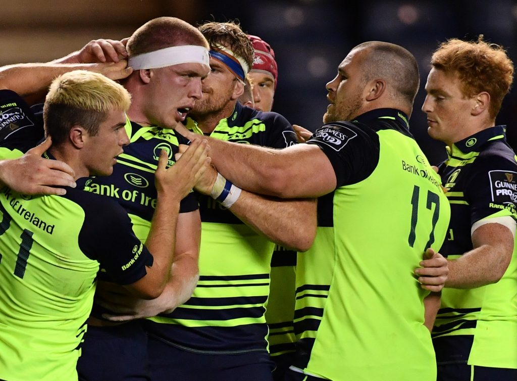 Flanker Dan Leavy is congratulated by his team-mates after scoring Leinster's fifth and final try against Edinburgh at BT Murrayfield