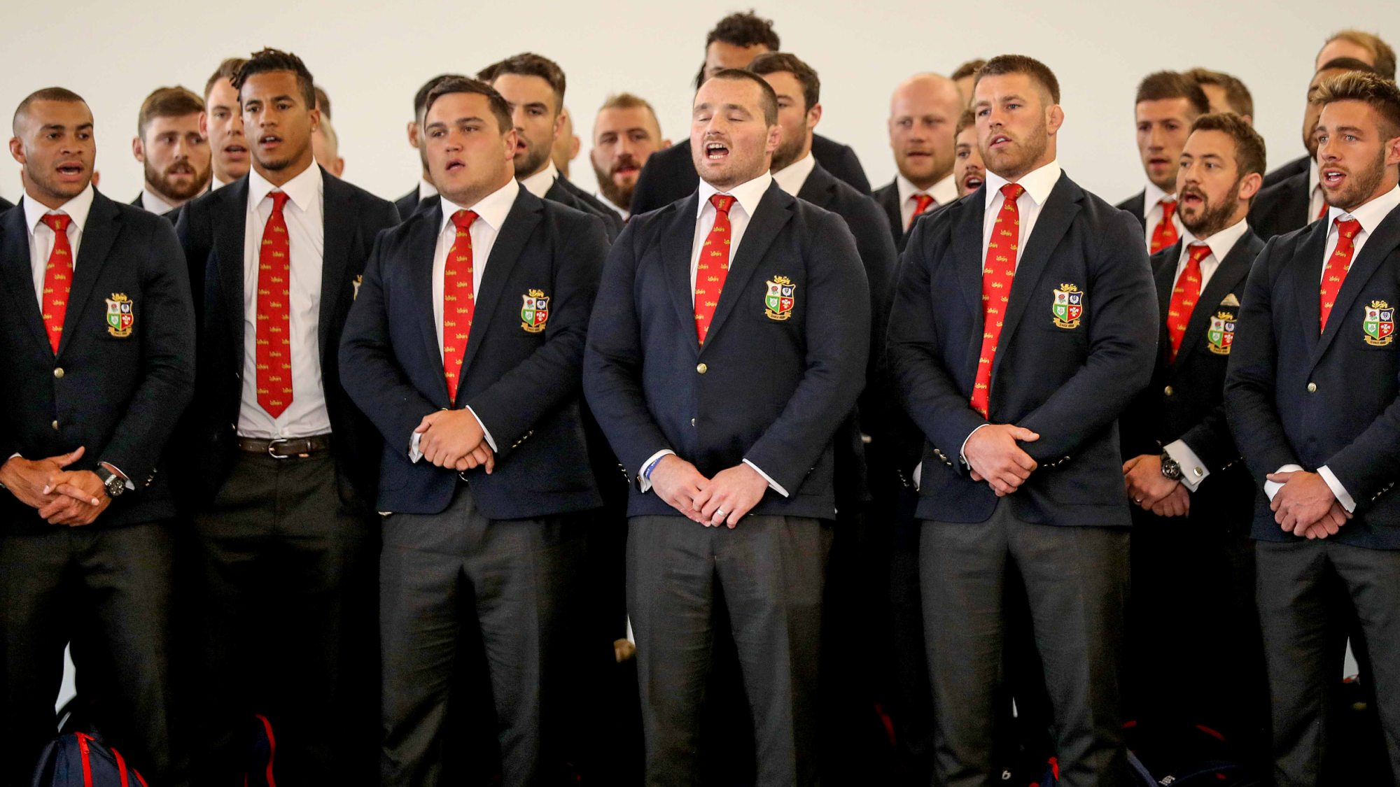 Video: The squad perform Calon Lân on arrival in Auckland