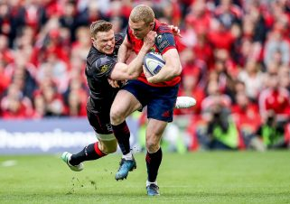 Keith Earls ties to break the tackle of Ashton.