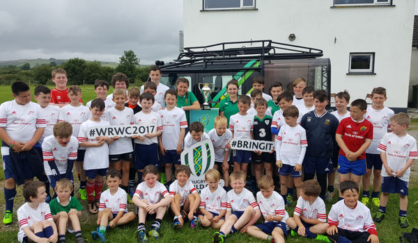 Anna Caplice and Liz Burke bring the Women's World Cup trophy to the Munster Rugby Summer Camp in Scariff