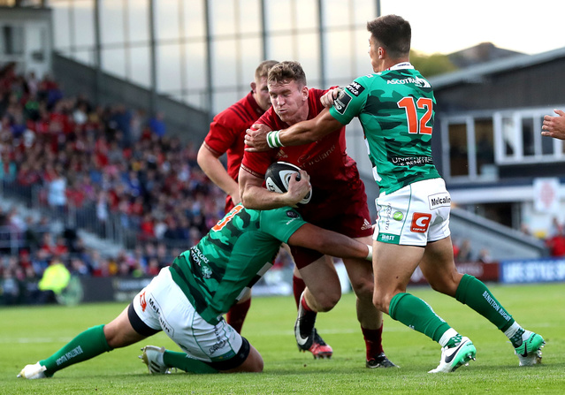 On his first competitive start for the province, Chris Farrell is tackled by Simone Farrari and Tommaso Allan.