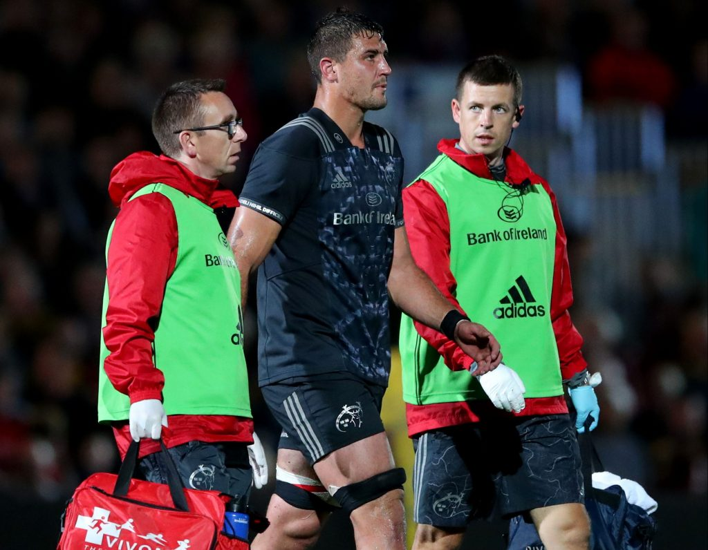 Munster's Gerbrandt Grobler with Doctor Martin McConaghy and physio Keith Thornhill.