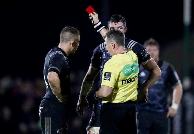 Referee Nigel Owens shows a red card to Andrew Conway.