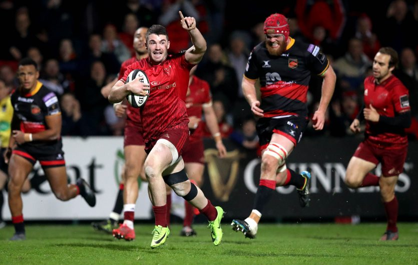Munster's Sam Arnold celebrates on his way to scoring a try