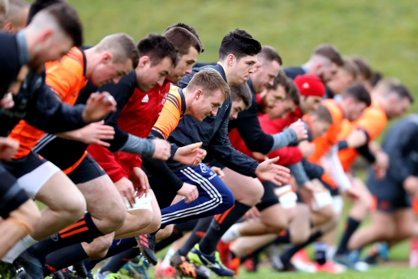 Munster players warm up at training in UL during the week.