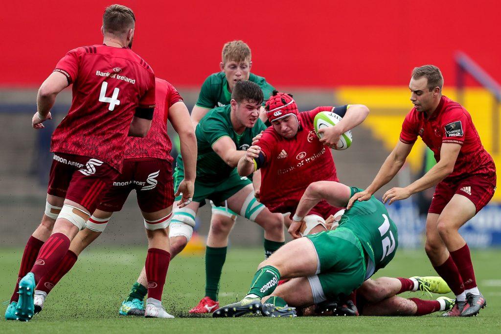 Munster's John Hodnett tackled by Peter Robb.