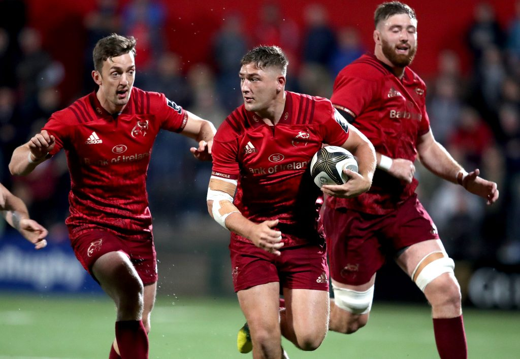 Dan Goggin on the run with support from Darren Sweetnam and Darren O'Shea.