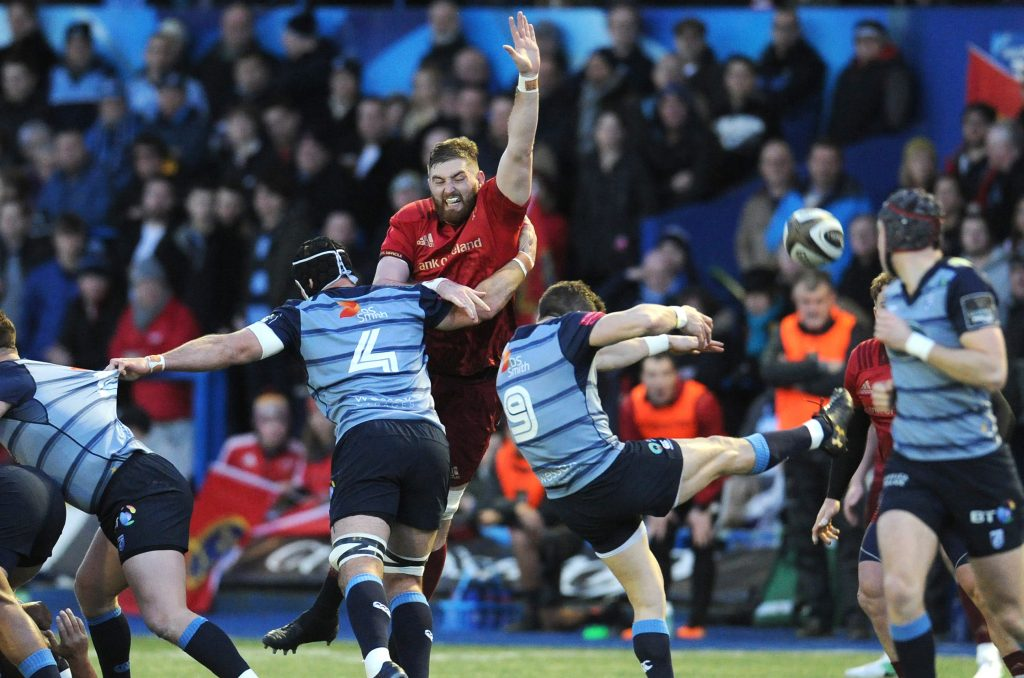 Munster's Darren O'Shea attempts to block Lloyd Williams' kick at the Arms Park last year.