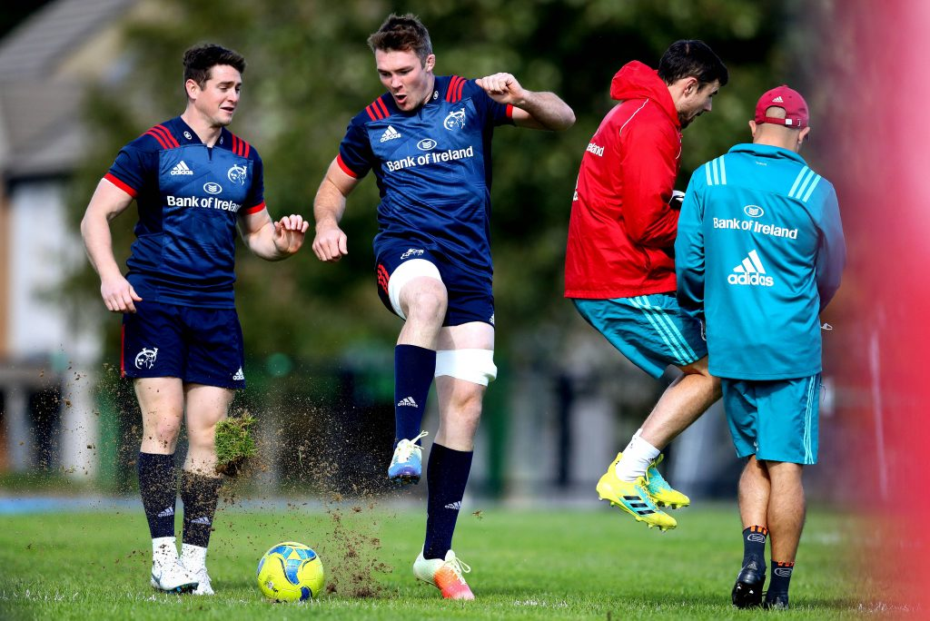 Peter O'Mahony displays his football skills in the warm-up before training.