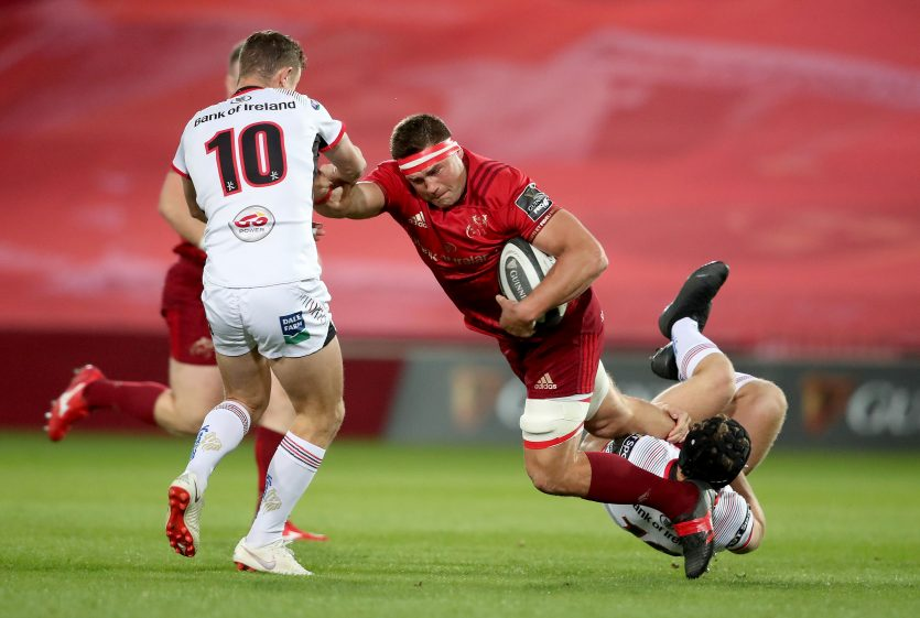 CJ Stander is tackled by Billy Burns and Angus Curtis.