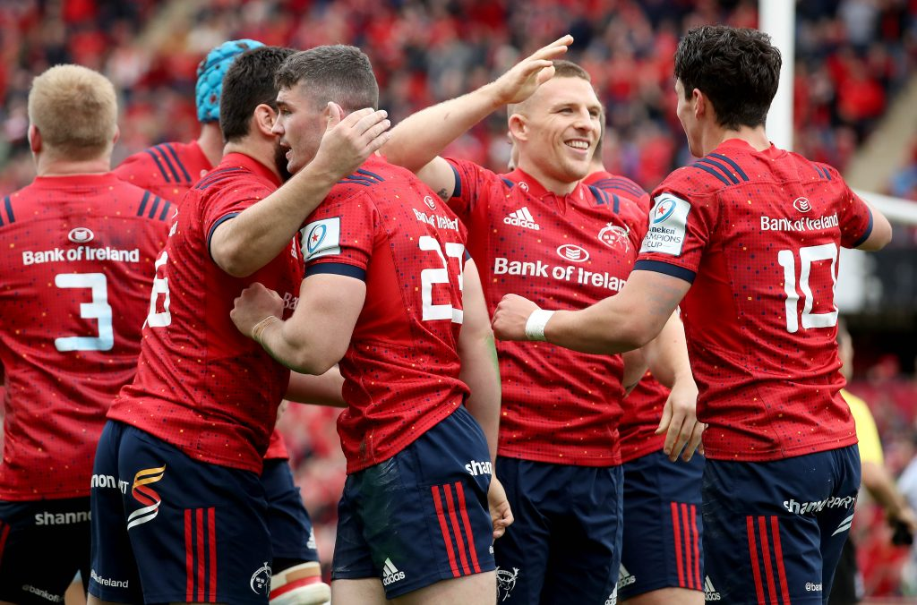 Munster players celebrate Sammy Arnold's try.