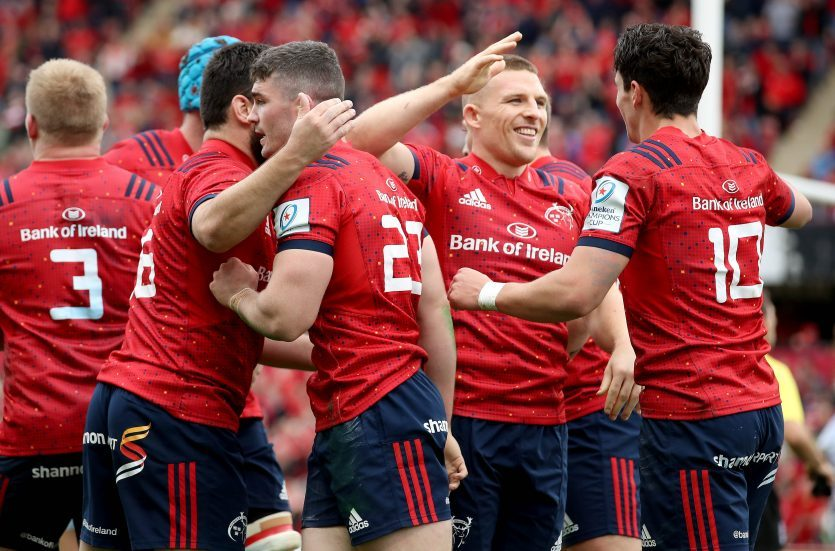 Munster players celebrate Sammy Arnold's try.