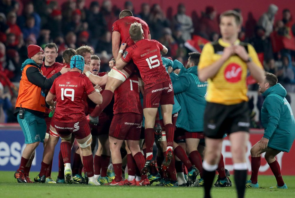 Munster celebrate at full-time.