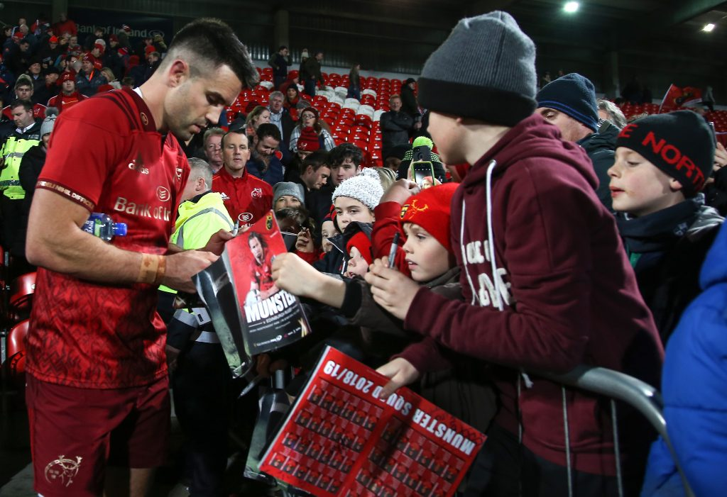 Conor Murray signs autographs for fans after the game.