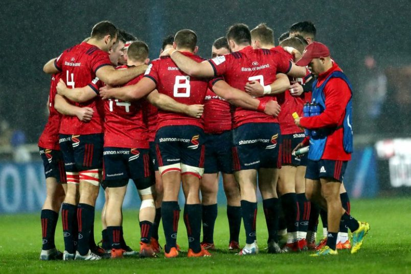 The Munster team huddle before kick-off.