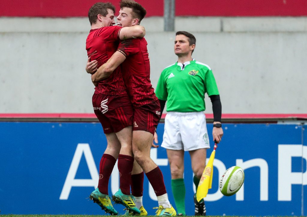 Alex McHenry celebrates scoring his try with Neil Cronin.