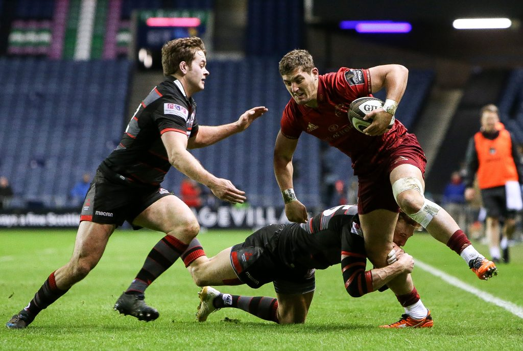Edinburgh v Munster in Murrayfield. Dan Goggin is tackled by Chris Dean and Dougie Fife in March '18.