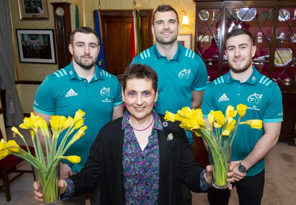 Munster's James Cronin, Tadhg Beirne and JJ Hanrahan with Sheila Hyde, long-term volunteer on Daffodil Day, at the Cork Daffodil Day Launch. Photo: Gerard McCarthy