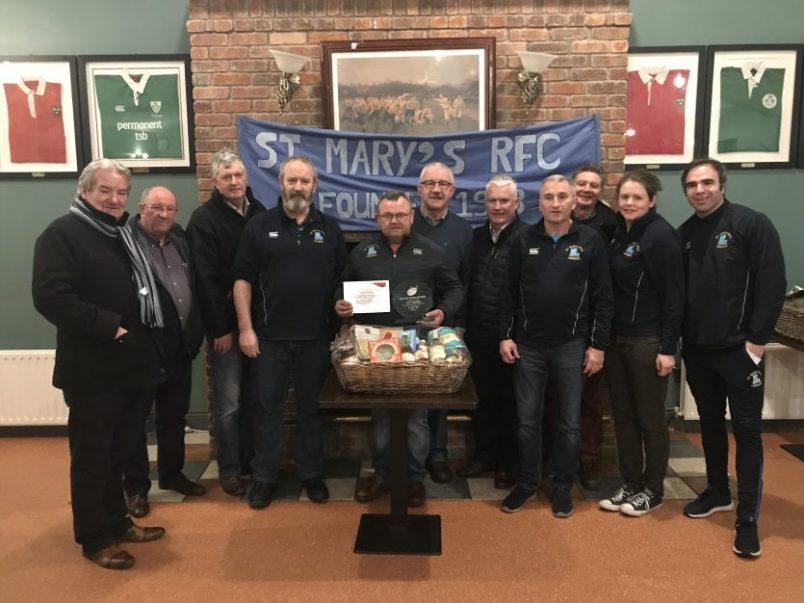 St. Mary's Christy McNamara (centre) was February's Volunteer of the Month Award winner.