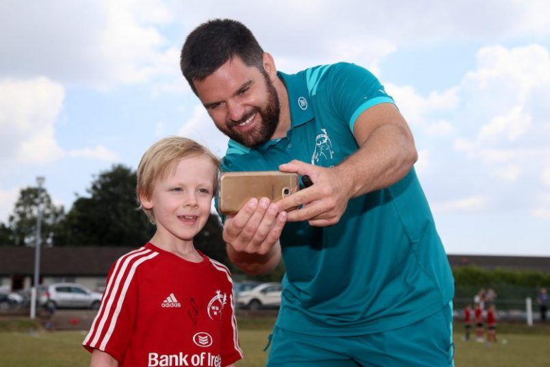 Munster's Kevin O'Byrne takes a selfie with a young fan at Highfield RFC.
