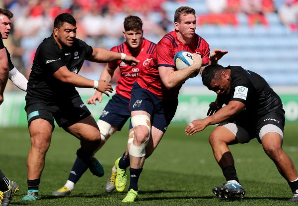 Chris Farrell is tackled by Mako Vunipola.