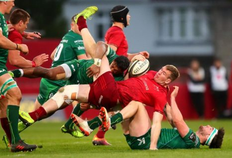 Chris Farrell is tackled by Bundee Aki and Tom Daly.