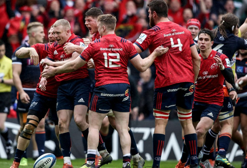 Keith Earls celebrates scoring their first try with team-mates.