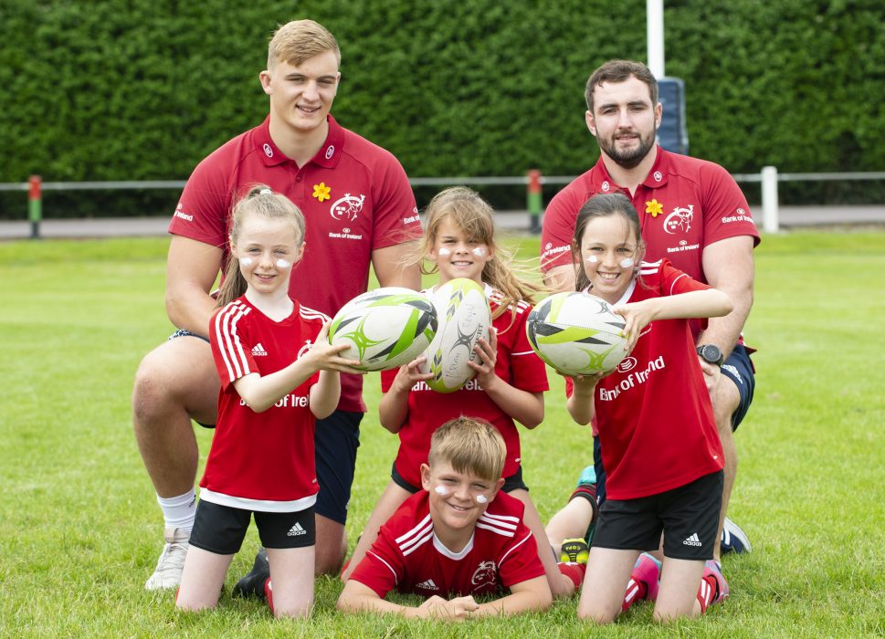 Munster players Gavin Coombes and James Cronin with participants of the Bank of Ireland Munster Rugby Summer Camp at Highfield RFC.