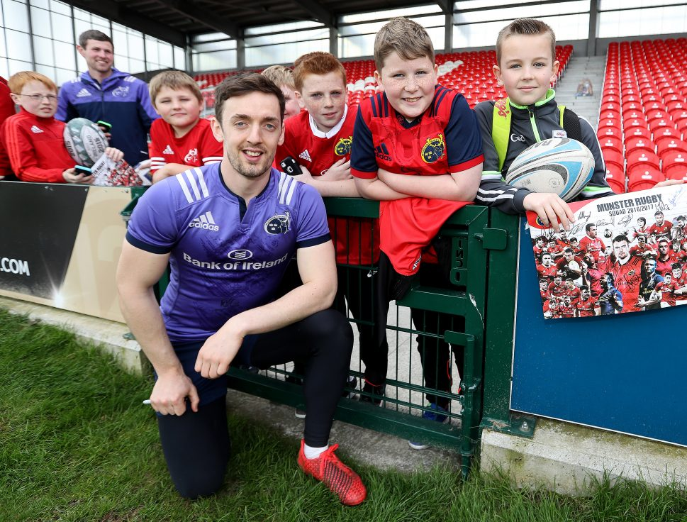 Darren Sweetnam with fans after training