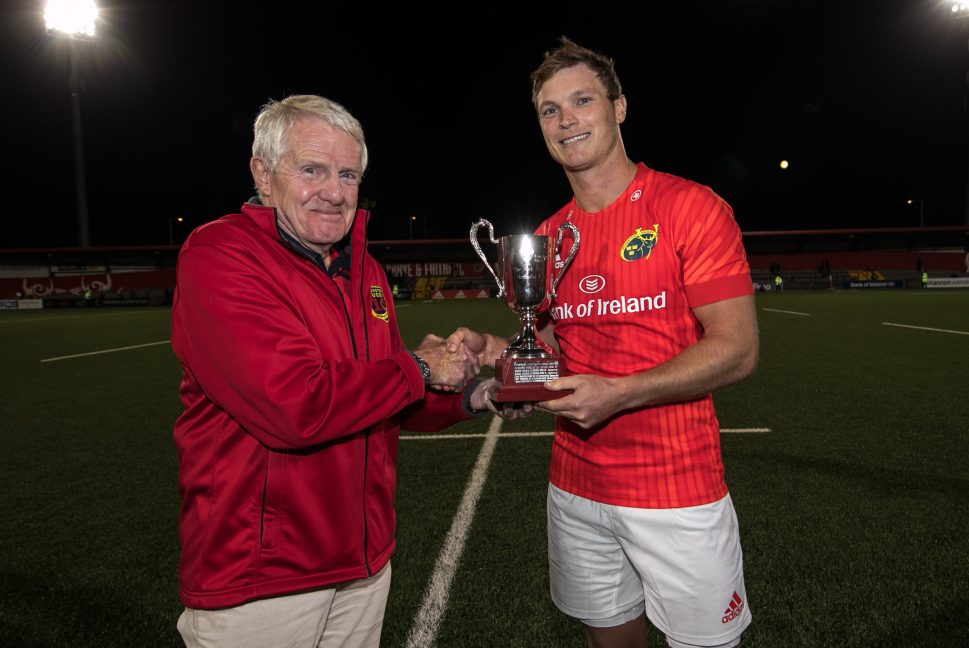 Tyler Bleyendaal is presented with the Jack Wakefield Memorial Trophy by Dr Paul McCarthy of the MRSC.