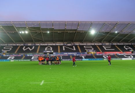 The Munster squad gather in a huddle following their captains run at the Liberty Stadium.
