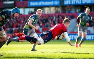 Craig Casey dives over for his first Munster try.