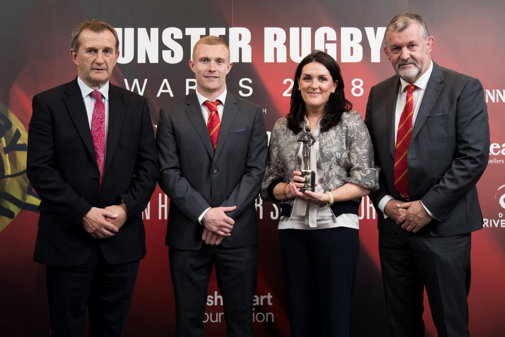 Former Munster Rugby CEO Garrett Fitzgerald, Keith Earls and Team Manager Niall O'Donovan present Olive Foley on behalf of Anthony Foley with the Hall Of Fame Award in 2018.