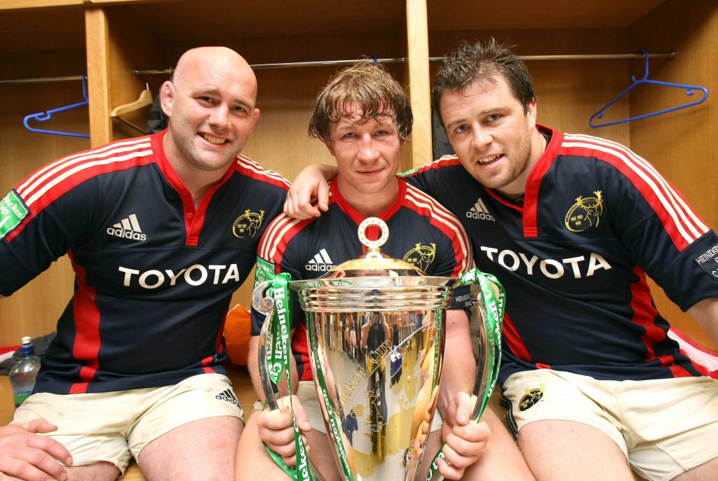John Hayes, Jerry Flannery and Marcus Horan in the changing room with the Heineken Cup Trophy in 2008.