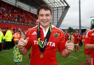 David Wallace celebrates the 2011 Magners League final win over Leinster with his Man of the Match award.
