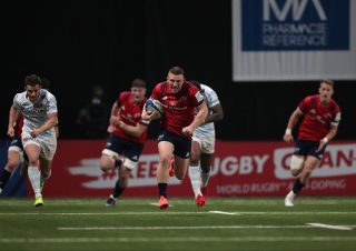 Andrew Conway runs in an intercept try against Racing 92.