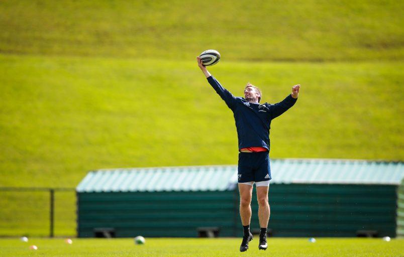 Darren Sweetnam catches a high ball in training.
