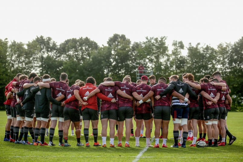 The Munster team huddle at training this week.