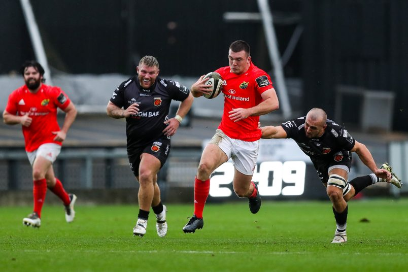 Matt Gallagher streaks clear of the Dragons defence.