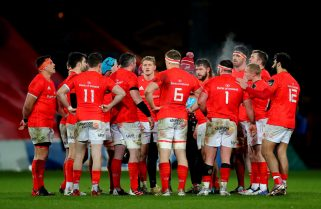 The Munster team huddle.