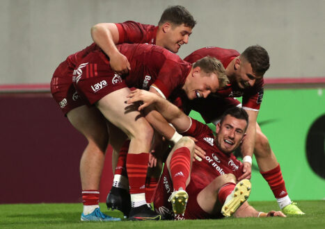JJ Hanrahan celebrates scoring a try against Ulster with Dan Goggin, Mike Haley and Shane Daly.