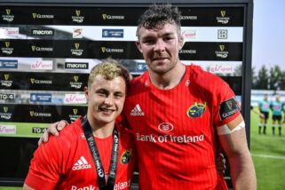 Craig Casey is presented with the Guinness PRO14 Player of the Match award by Peter O