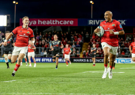 Simon Zebo runs in a try with Mike Haley in support.