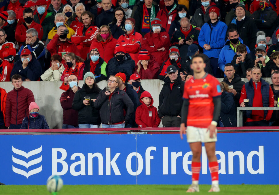 Munster supporters watch on as Joey Carbery lines up a kick at goal.