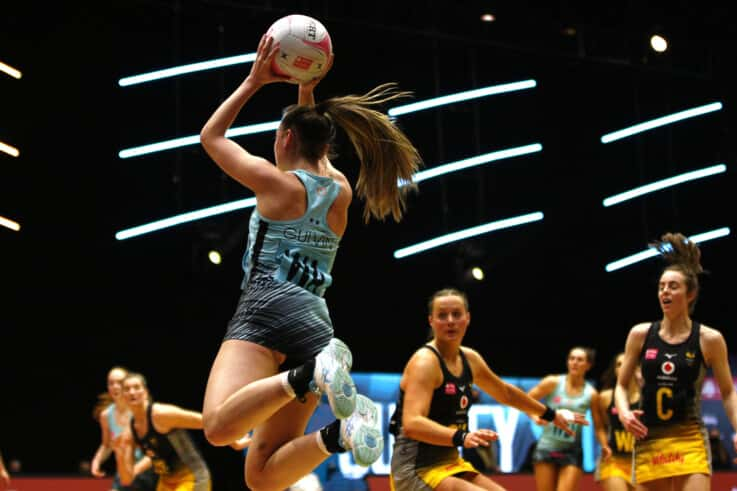Emily Gulvin jumps for the ball as Surrey Storm play Wasps (Morgan Harlow)