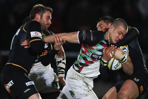 Quins win at Wasps to stay top of the league