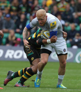 NORTHAMPTON, ENGLAND - SEPTEMBER 03:  Tom Homer of Bath is tackled by George Pisi of Northampton Saints during the Aviva Premiership match between Northampton Saints and Bath at Franklin's Gardens on September 3, 2016 in Northampton, England.  (Photo by Pete Norton/Getty Images)